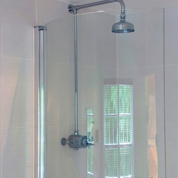 a picture of a bathroom with free standing shower and toilet