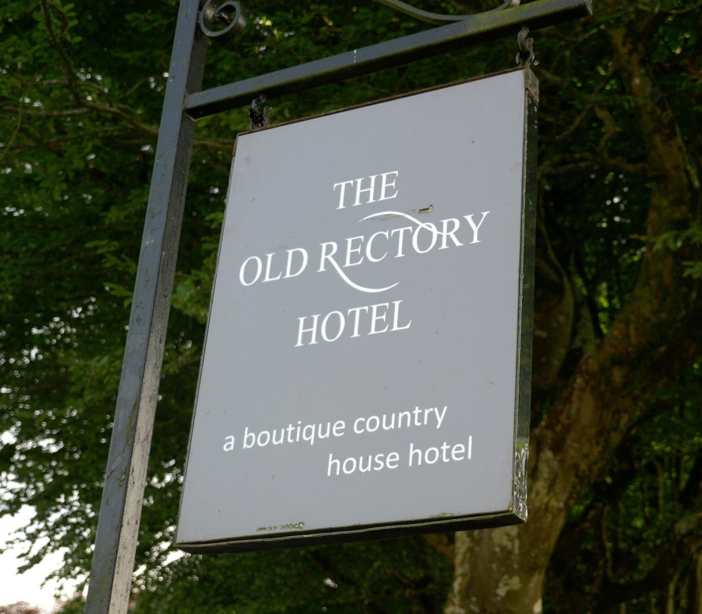 a picture of the old rectory hotel sign outside