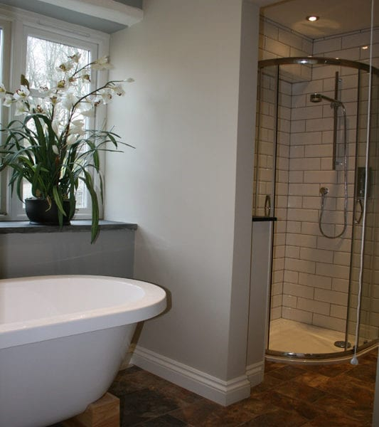 a picture of a freestanding bath and a freestanding shower